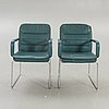 A pair of kinnarps leather and chromium armchairs later part of the 20th century.