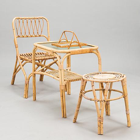 A 1950s three-piece set of rattan furniture and a rattan tray by urjalan koritehdas, finland.