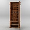A pine book cabinet, from around the year 1900.