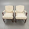 A pair of ellinor armchairs from bröderna andersson later part of the 20th century.