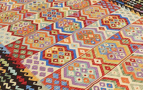 A carpet, kilim, ca 373 x 282 cm.