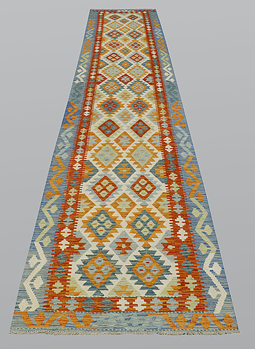 A runner, kilim, ca 487 x 83 cm.