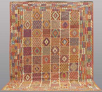 A carpet, kilim, ca 395 x 306 cm.