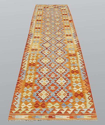A runner, kilim, ca 391 x 81 cm.