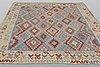 A carpet, kilim, ca 290 x 257 cm.