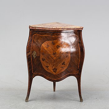 A second half of the 19th century Louis XV-style corner cabinet.