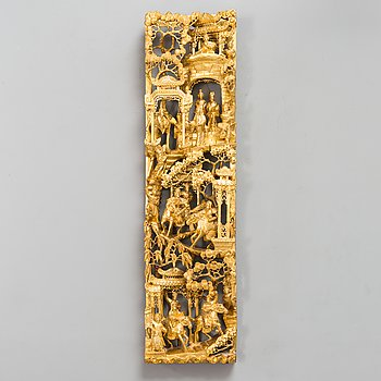 A Chinese carved and gilt wood panel, 20th century.