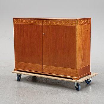 A mahogany cupboard by Carl Malmsten, mid 20th Century.