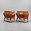 A pair of rococo style chest of drawers, mid 20th century.