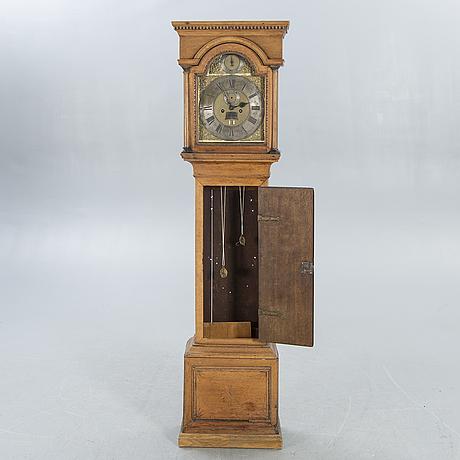 An english 18th century oak grandfather clock marked tho pierece new romney.