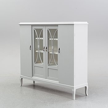 A vitrine cabinet, first half of the 20th Century.