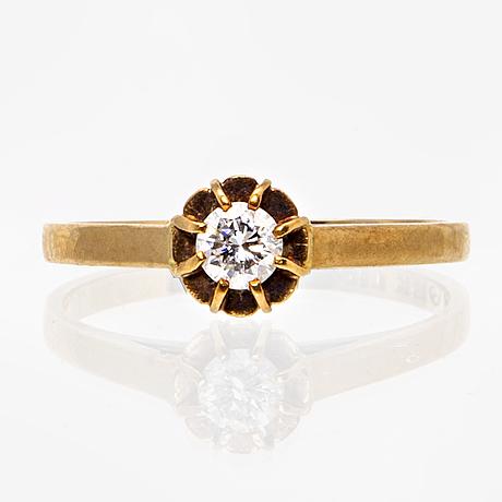 Ring 18k guld med 1 briljant 0,16 ct enligt gravyr, ringstorlek ca 15,25/48,5.