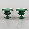 A pair of cast iron garden urns, 20th centry.