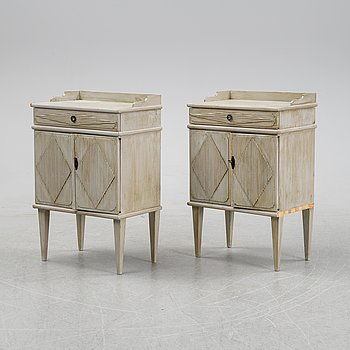 A pair of Gustavian style bedside tables, first half of the 20th century,.