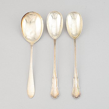 Three silver spoons, by Anders Nilsson, Lund, 1928, and by Anna Östergren, Malmö, 1927.