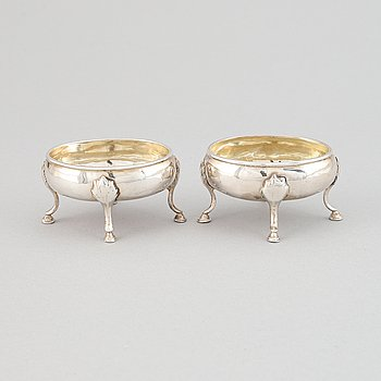 A pair of silver saltcellars, London, England.