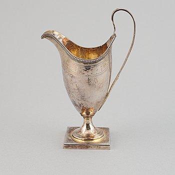 A silver creamer, indistinct makers mark, London, 1791.