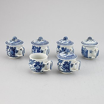 A set of six blue and white custard cups with covers,