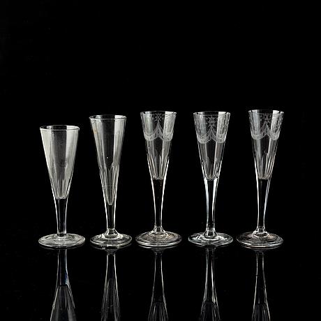 Five antique champagne glasses.