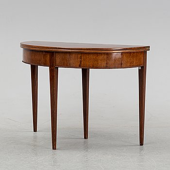 A late Gustavian mahogany game table, first half of the 19th century,
