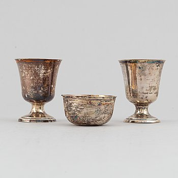 A silver tumbler and two small silver cups, unknown marks, 18-19th century.