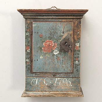 A Swedish painted wall cabinet dated 1796.