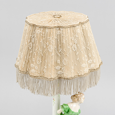 A creamware table lamp from goldscheider, austria, first half of the 20th century.
