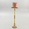 A mid 20th century wood floor lamp from paoletti, firenze italy.
