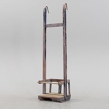 A childrens swing, around the year 1900.