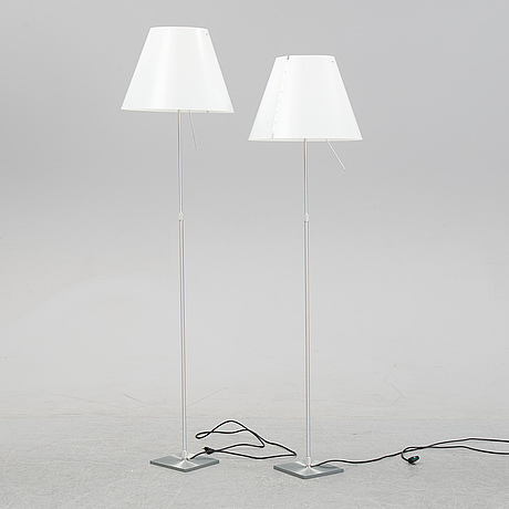 A pair of 'costanza' floor lamps, by paolo rizzatto, luceplan, italy.