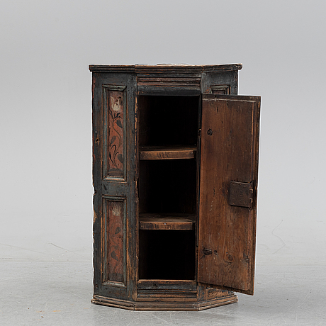 A swedish painted corner cabinet, probably from västergötland, dated 1772.