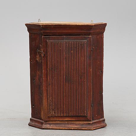 A swedish painted corner cabinet, 19th century.