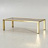 A brass coffee table alter part of the 20th century.