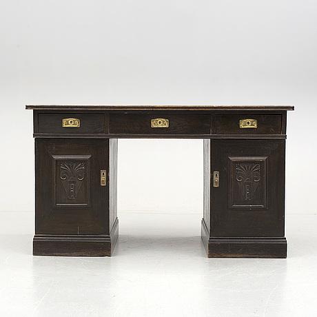 An early 1900s oak writing desk.
