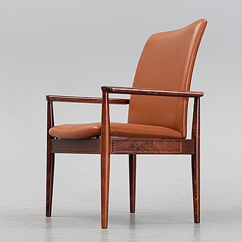 Finn Juhl, a rosewood easy chair, from Cado, Denmark, 1960's/70's.