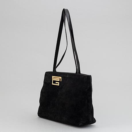 Gucci, a black suede handbag.