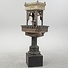 A painted and richly decorated plate garden fountain, late 19th century.