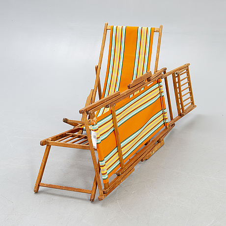 Sun loungers, a pair of footstools, 1950s.