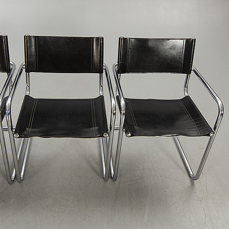 A set of four italian chrome and leather chairs later part of the 20th century.