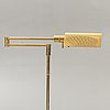 A brass floor lamp later part of the 20th century.