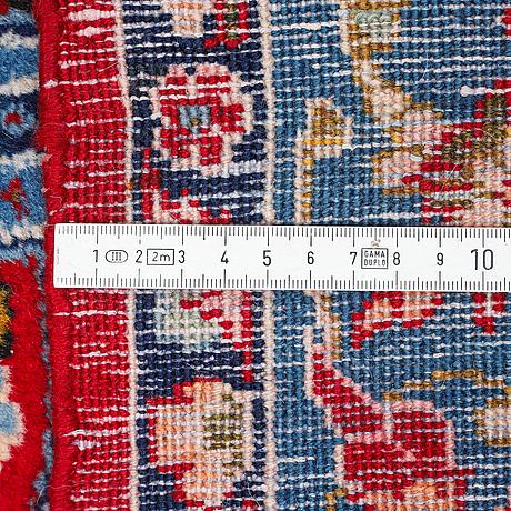 A carpet, semi-antique qum, ca 297 x 212 cm.