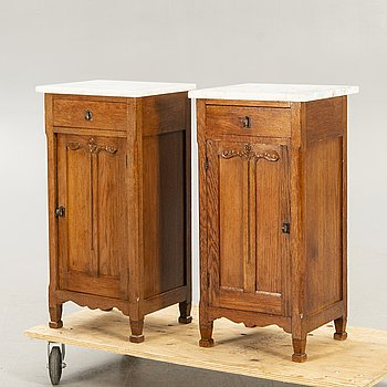A pair of oak and marble bedside tables early 1900s.