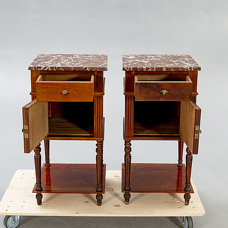 A pair of mahogany and marble bedside tables first half of the 20th century.
