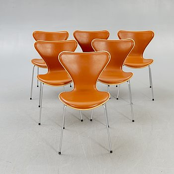 Arne Jacobsen, a set of six Sjuan leather and wood chairs for Fritz Hansen 2006.