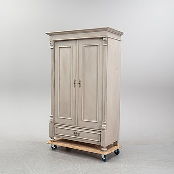 A painted cabinet from around the year 1900.