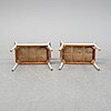 A pair of stools, 20th century.