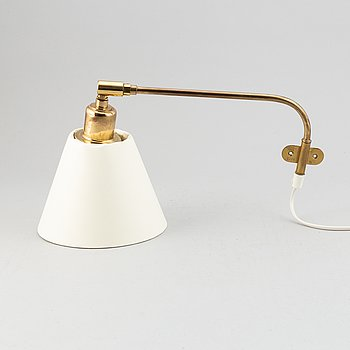A model 2226 brass wall light by Josef Frank for Firma Svenskt Tenn.