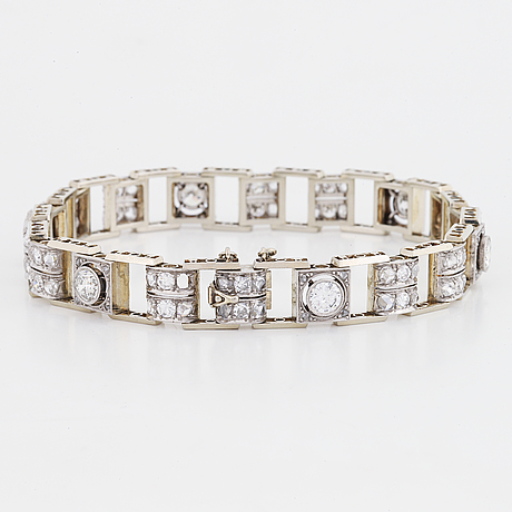 An 18k white gold bracelet set with old- and rose-cut diamonds.