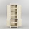A contemporary gustavian style cabinet.