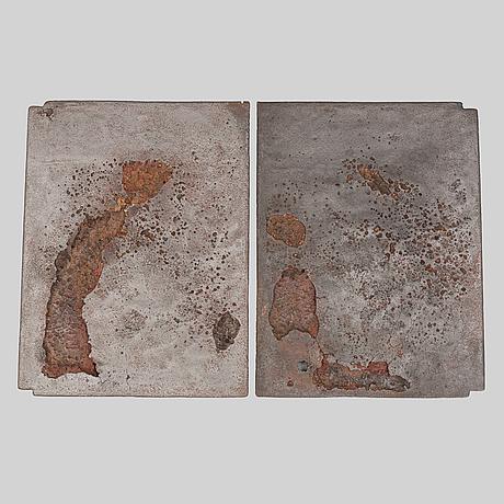 A pair of cast iron stove panels, diö bruk.